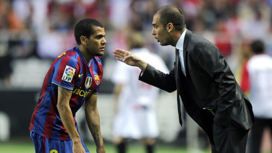 Barcelona's coach Pep Guardiola (R) spea