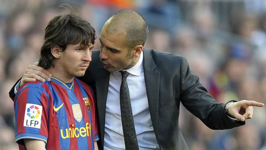 Barcelona's coach Pep Guardiola (R) talk