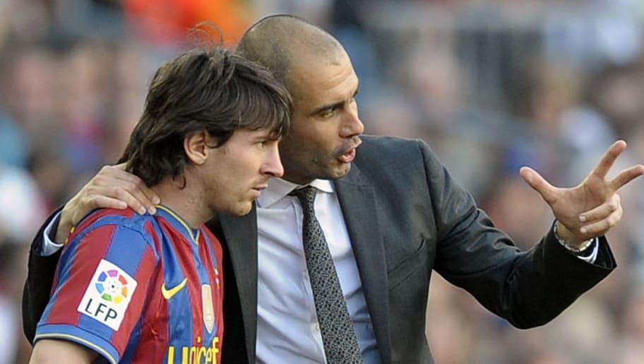 Barcelona's coach Pep Guardiola talks wi
