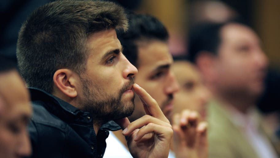 Barcelona's defender Gerard Pique gestures during Barcelona coach's press conference in Barcelona on April 27, 2012. Barcelona's coach Pep Guardiola announced today he is leaving the club at the end of the season, ending a four-year reign over one of the greatest eras in club football. 'This is not a very easy situation for me,' the 41-year-old Guardiola told a news conference where the club also revealed that his assistant coach Tito Vilanova will take over.  AFP PHOTO / LLUIS GENE        (Photo credit should read LLUIS GENE/AFP/GettyImages)