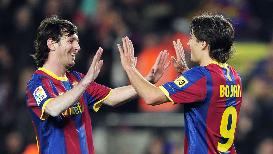 Barcelona's forward Bojan Krkic (R) celebrates with his team-mate Barcelona's Argentinian forward Lionel Messi (L) after scoring against Real Sociedad during their Spanish league football match at the Camp Nou stadium in Barcelona on December 12, 2010.  FC Barcelona won 5-0.   AFP PHOTO/ JOSEP LAGO (Photo credit should read JOSEP LAGO/AFP/Getty Images)
