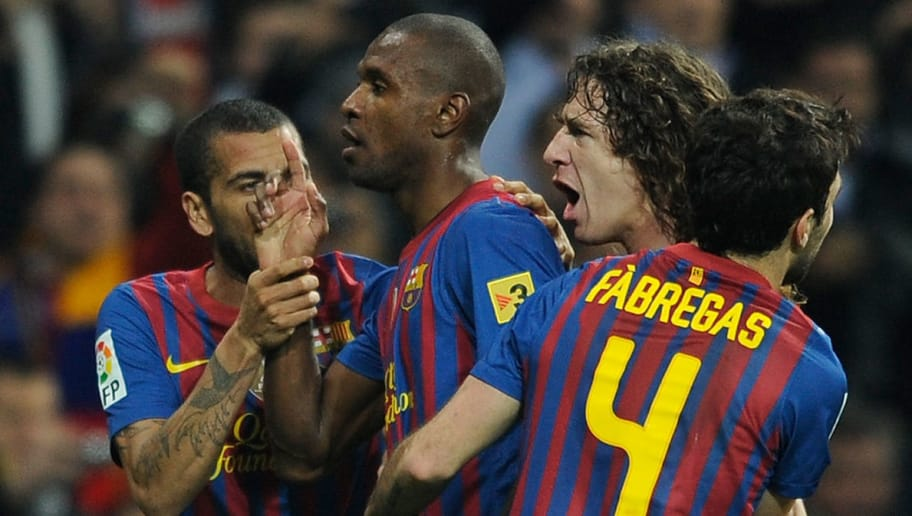 Barcelona's French defender Eric Abidal (2L) celebrates with teammates Barcelona's Brazilian defender Dani Alves, Barcelona's captain Carles Puyol and Barcelona's midfielder Cesc Fabregas after scoring during the Spanish Cup 'El clasico' football match Real Madrid vs Barcelona at the Santiago Bernabeu stadium in Madrid on January 18, 2011. Barcelona won 1-2. AFP PHOTO/ DANI POZO (Photo credit should read DANI POZO/AFP/Getty Images)