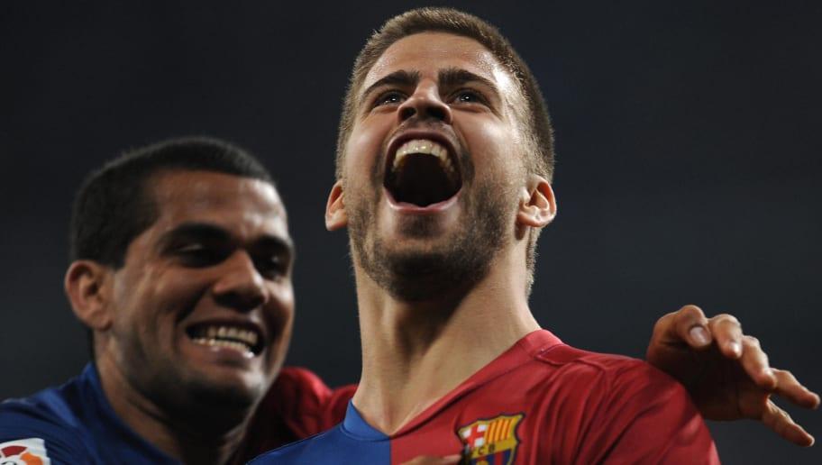 Barcelona's Gerard Pique (R) celebrates