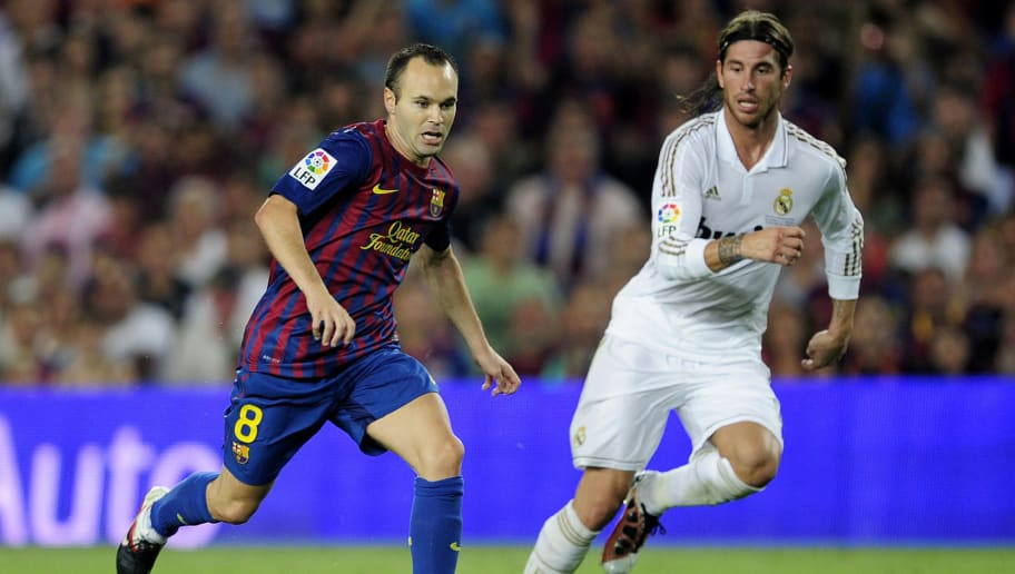 Barcelona's midfielder Andres Iniesta (L) vies with Real Madrid's defender Sergio Ramos (R) during the second leg of the Spanish Supercup football match FC Barcelona vs Real Madrid CF on August 17, 2011 at the Camp Nou stadium in Barcelona.     AFP PHOTO/ JOSEP LAGO (Photo credit should read JOSEP LAGO/AFP/Getty Images)