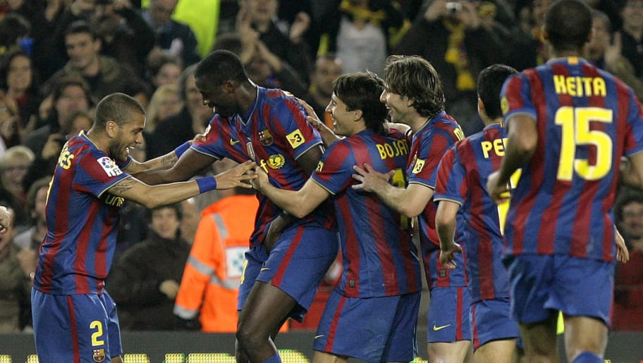 Barcelona's midfielder Yaya Toure from Ivory Coast  (2L) is congratuled by his teammates  after scoring during a Spanish League football match against Deportivo Coruna at the Camp Nou Stadium in Barcelona , on April 14, 2010. AFP PHOTO / JOSEP LAGO (Photo credit should read JOSEP LAGO/AFP/Getty Images)