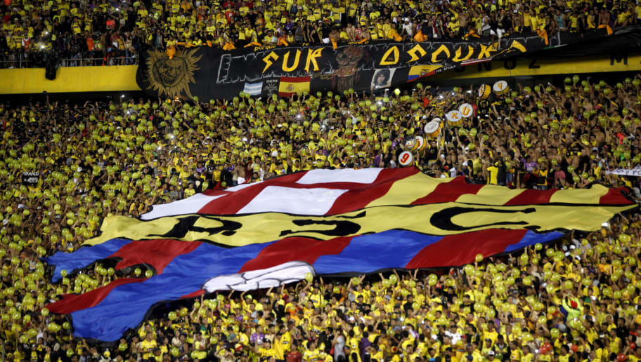 GUAYAQUIL, ECUADOR - OCTOBER 25: Fans of Barcelona cheer for their team prior a first leg match between Barcelona SC and Gremio as part of the semifinals of Copa CONMEBOL Libertadores Bridgestone 2017 at Monumental Isidro Romero Carbo Stadium on October 25, 2017 in Guayaquil, Ecuador. (Photo by Franklin Jacome/Getty Images)