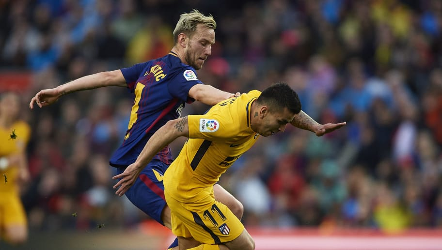 BARCELONA, SPAIN - MARCH 04:  Ivan Rakitic (L) of Barcelona competes for the ball with Angel Martin Correa of Atletico de Madrid during the La Liga match between FC Barcelona and Atletico de Madrid at Camp Nou on March 4, 2018 in Barcelona, Spain.  (Photo by Quality Sport Images/Getty Images)