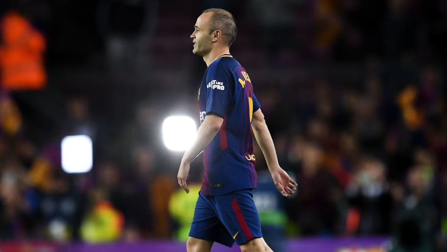 BARCELONA, SPAIN - MAY 06:  Andres Iniesta of FC Barcelona walks onto the pitch after the La Liga match between Barcelona and Real Madrid at Camp Nou on May 6, 2018 in Barcelona, Spain.  (Photo by David Ramos/Getty Images)