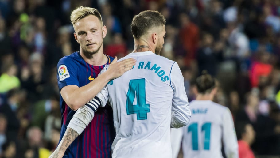 BARCELONA, SPAIN - MAY 06: Sergio Ramos (R) of Real Madrid hugs Ivan Rakitic of FC Barcelona after the La Liga match between Barcelona and Real Madrid at Camp Nou on May 6, 2018 in Barcelona, Spain. (Photo by Power Sport Images/Getty Images)