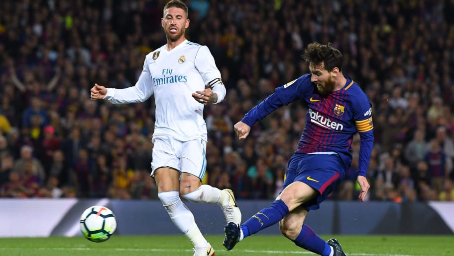 BARCELONA, SPAIN - MAY 06:  Lionel Messi of FC Barcelona shoots towards goal during the La Liga match between Barcelona and Real Madrid at Camp Nou on May 6, 2018 in Barcelona, Spain.  (Photo by David Ramos/Getty Images)