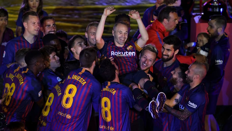 BARCELONA, SPAIN - MAY 20:  Andres Iniesta of FC Barcelona is tossed into the air by his team mates at the end of the La Liga match between Barcelona and Real Sociedad at Camp Nou on May 20, 2018 in Barcelona, Spain.  (Photo by David Ramos/Getty Images)