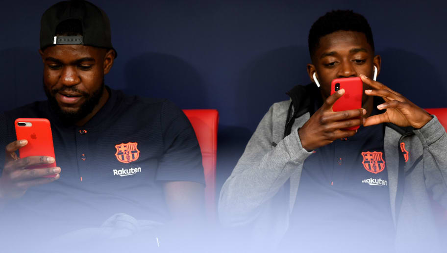 MADRID, SPAIN - APRIL 21: Barcelona pair Samuel Umtiti and Ousmane Dembele chat in the dug out ahead of the Spanish Copa del Rey Final between Barcelona and Sevilla at Wanda Metropolitano on April 21, 2018 in Madrid, Spain. (Photo by David Ramos/Getty Images)