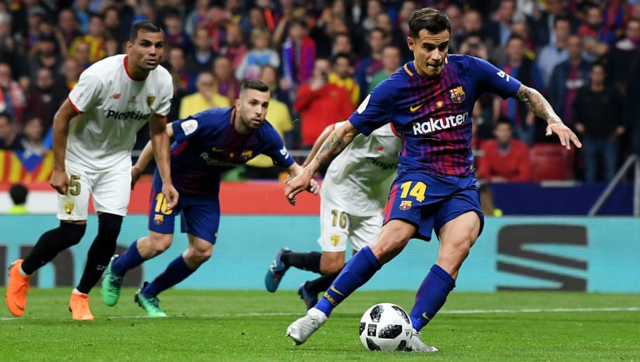 MADRID, SPAIN - APRIL 21: Philippe Coutinho of Barcelona scores from the spot for the teams fifth goal during the Spanish Copa del Rey match between Barcelona and Sevilla at Wanda Metropolitano on April 21, 2018 in Barcelona, . (Photo by David Ramos/Getty Images)