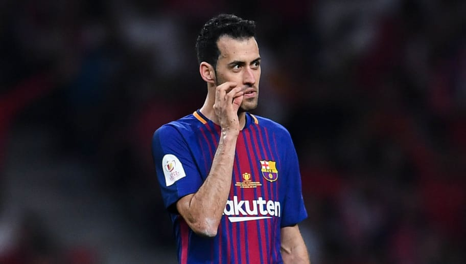 BARCELONA, SPAIN - APRIL 21:  Sergio Busquets of FC Barcelona reacts during the Spanish Copa del Rey Final match between Barcelona and Sevilla at Wanda Metropolitano stadium on April 21, 2018 in Barcelona, Spain.  (Photo by David Ramos/Getty Images)
