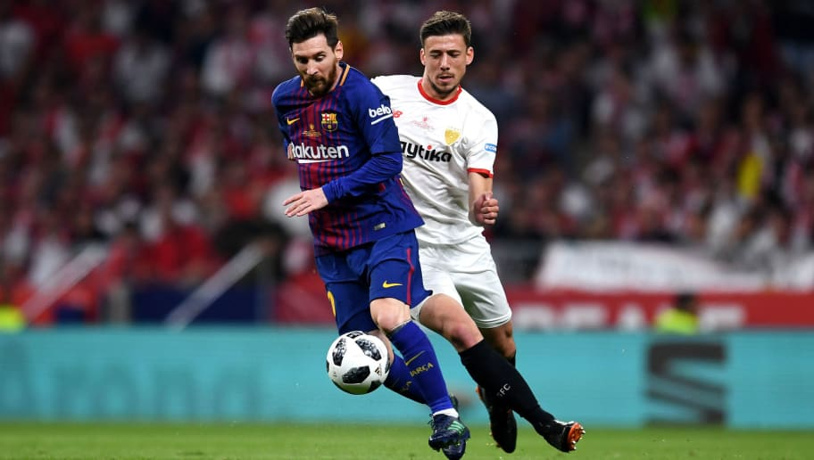 MADRID, SPAIN - APRIL 21: Lionel Messi of Barcelona looks to hold off Clement Lenglet of Sevilla's during the Spanish Copa del Rey match between Barcelona and Sevilla at Wanda Metropolitano on April 21, 2018 in Barcelona, . (Photo by David Ramos/Getty Images)