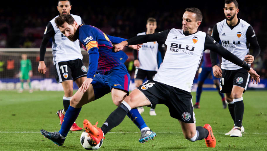 BARCELONA, SPAIN - FEBRUARY 01:  Nemanja Maksimovic of Valencia CF tackles Lionel Messi of FC Barcelona during the Copa del Rey semi-final first leg match between FC Barcelona and Valencia CF at Camp Nou on February 1, 2018 in Barcelona, Spain.  (Photo by Alex Caparros/Getty Images)