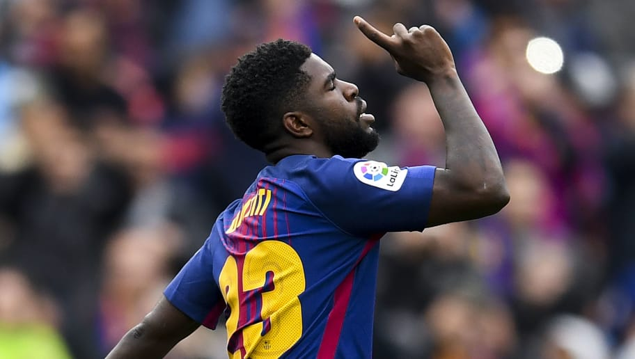 BARCELONA, SPAIN - APRIL 14:  Samuel Umtiti of FC Barcelona celebrates after scoring his team's second goal during the La Liga match between Barcelona and Valencia at Camp Nou on April 14, 2018 in Barcelona, Spain.  (Photo by David Ramos/Getty Images)