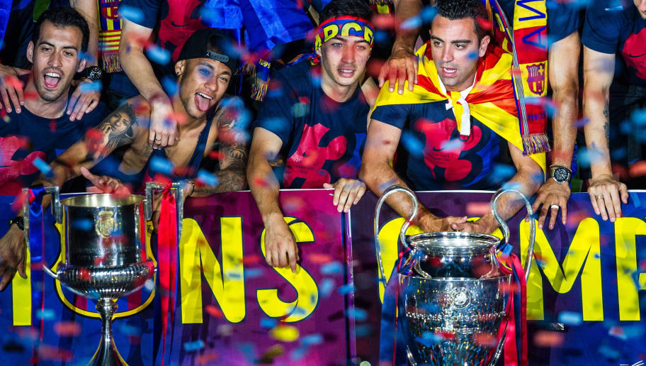BARCELONA, SPAIN - JUNE 07: FC Barcelona players celebrate with La Liga, Copa del Rey and Champions League trophies during their victory parade after winning the UEFA Champions League Final at the Camp Nou Stadium on June 7, 2015 in Barcelona, Spain. (Photo by David Ramos/Getty Images)