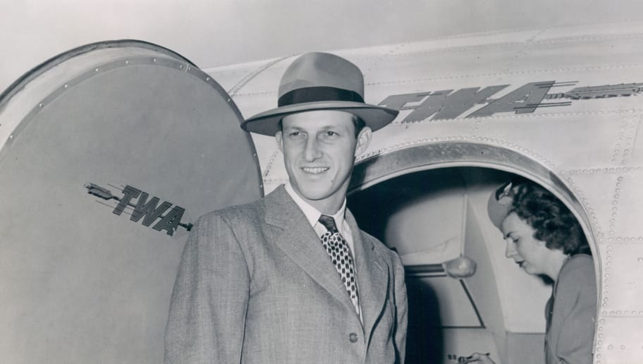 UNSPECIFIED - UNDATED: St.Louis Cardinal Stan Musial, 1947 National League MVP, coming off a TWA flight (Photo by John Kanuit Photography/Sports Studio Photos/Getty Images)
