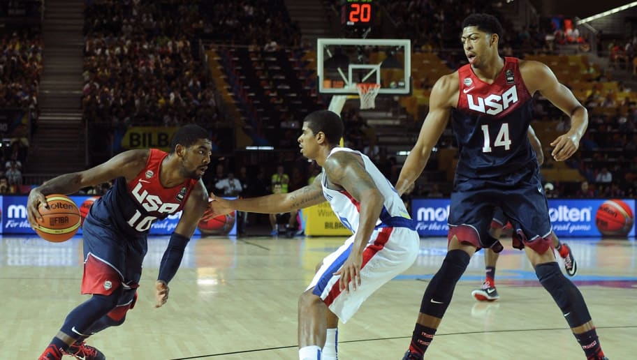 Dominican Republic's guard Edgar Sosa (C) vies with US centre Anthony Davis (R) and US guard Kyrie Irving (L) during the 2014 FIBA World basketball championships group C match Dominican Republic vs USA at the Bizkaia Arena in Bilbao on September 3, 2014.  AFP PHOTO / ANDER GILLENEA        (Photo credit should read ANDER GILLENEA/AFP/Getty Images)