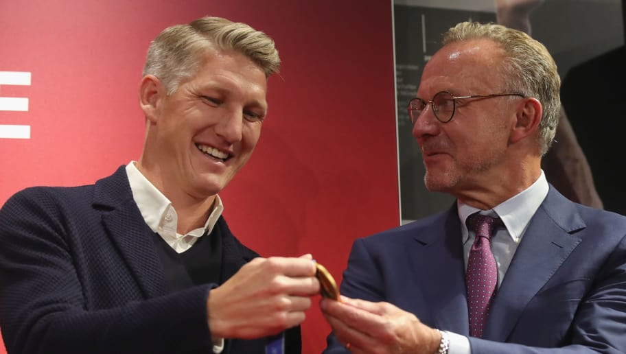 MUNICH, GERMANY - AUGUST 27:  Bastian Schweinsteiger present his Gold Medal for winning the FIFA World Cup Brazil 2014 to  Karl-Heinz Rummenigge, CEO of FC Bayern Muenchen as hi is admitted in the FC Bayern Muenchen Hall of Fame at FCB Erlebniswelt Museum Allianz Arena on August 27, 2018 in Munich, Germany.  (Photo by Alexander Hassenstein/Bongarts/Getty Images)