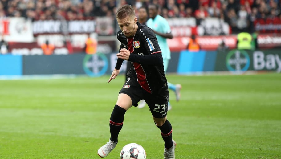 LEVERKUSEN, GERMANY - SEPTEMBER 23: Mitchell Weiser #23 of Bayer Leverkusen controls the ball during the Bundesliga match between Bayer 04 Leverkusen and 1. FSV Mainz 05 at BayArena on September 22, 2018 in Leverkusen, Germany. (Photo by Maja Hitij/Bongarts/Getty Images)
