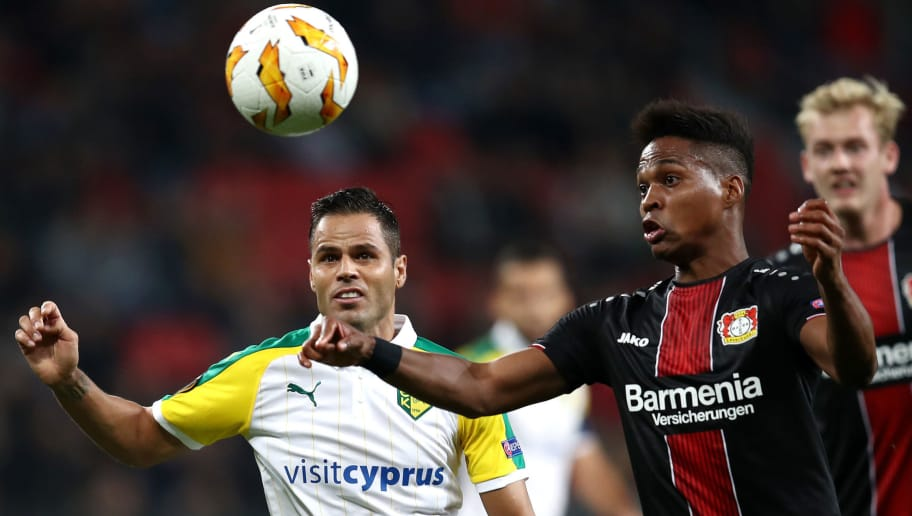 LEVERKUSEN, GERMANY - OCTOBER 04:  Acoran of AEK Larnaca FC battles for possession with Borges Wendell of Bayer 04 Leverkusen during the UEFA Europa League Group A match between Bayer 04 Leverkusen and AEK Larnaca  at BayArena on October 4, 2018 in Leverkusen, Germany.  (Photo by Maja Hitij/Getty Images)