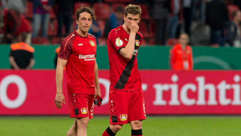 LEVERKUSEN, GERMANY - APRIL 17: Julian Baumgartlinger of Leverkusen and Lars Bender of Leverkusen look dejected after the DFB Cup semi final match between Bayer 04 Leverkusen and Bayern Munchen at BayArena on April 17, 2018 in Leverkusen, Germany. (Photo by TF-Images/Getty Images)