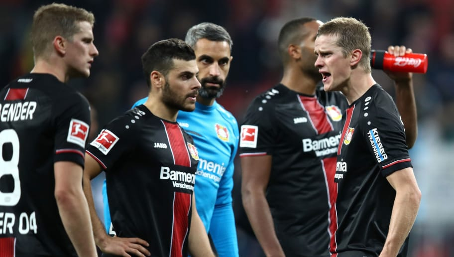 LEVERKUSEN, GERMANY - SEPTEMBER 29:  (L-R) Lars Bender of Bayer 04 Leverkusen, Kevin Volland of Bayer 04 Leverkusen and Sven Bender of Bayer 04 Leverkusen react after defeat in the Bundesliga match between Bayer 04 Leverkusen and Borussia Dortmund at BayArena on September 29, 2018 in Leverkusen, Germany.  (Photo by Maja Hitij/Bongarts/Getty Images)