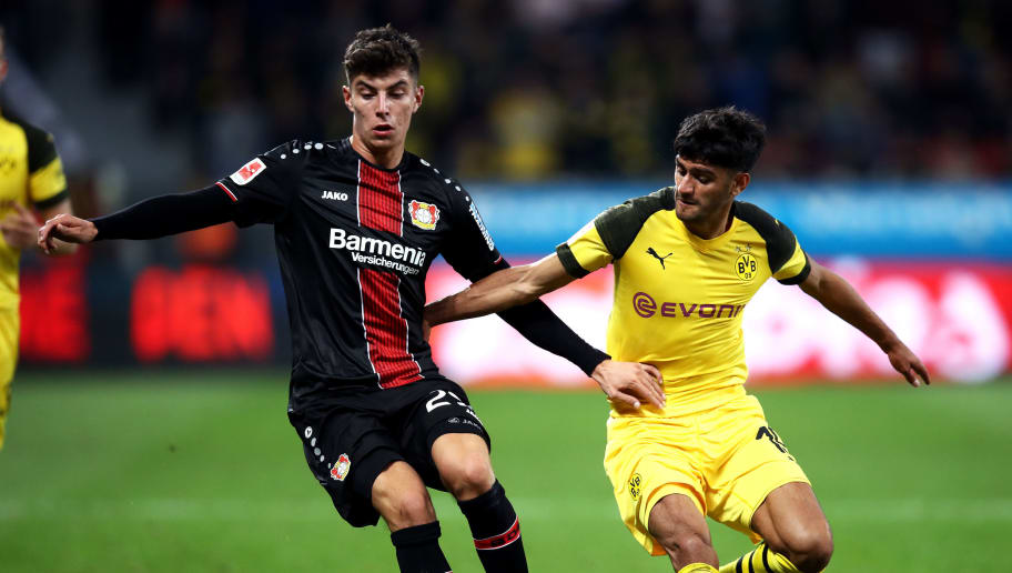 LEVERKUSEN, GERMANY - SEPTEMBER 29:  Kai Havertz of Bayer 04 Leverkusen and Mahmoud Dahoud of Borussia Dortmund compete for the ball during the Bundesliga match between Bayer 04 Leverkusen and Borussia Dortmund at BayArena on September 29, 2018 in Leverkusen, Germany.  (Photo by Maja Hitij/Bongarts/Getty Images)