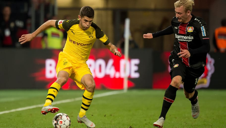 LEVERKUSEN, GERMANY - SEPTEMBER 29: Christian Pulisic of Borussia Dortmund and Julian Brandt of Leverkusen battle for the ball during the Bundesliga match between Bayer 04 Leverkusen and Borussia Dortmund at BayArena on September 29, 2018 in Leverkusen, Germany. (Photo by TF-Images/Getty Images)