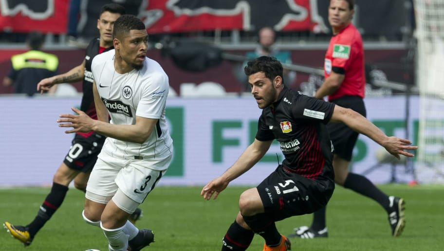 LEVERKUSEN, GERMANY - APRIL 14: Simon Falette of Frankfurt and Kevin Volland of Leverkusen battle for the ball during the Bundesliga match between Bayer 04 Leverkusen and Eintracht Frankfurt at BayArena on April 14, 2018 in Leverkusen, Germany. (Photo by TF-Images/Getty Images)