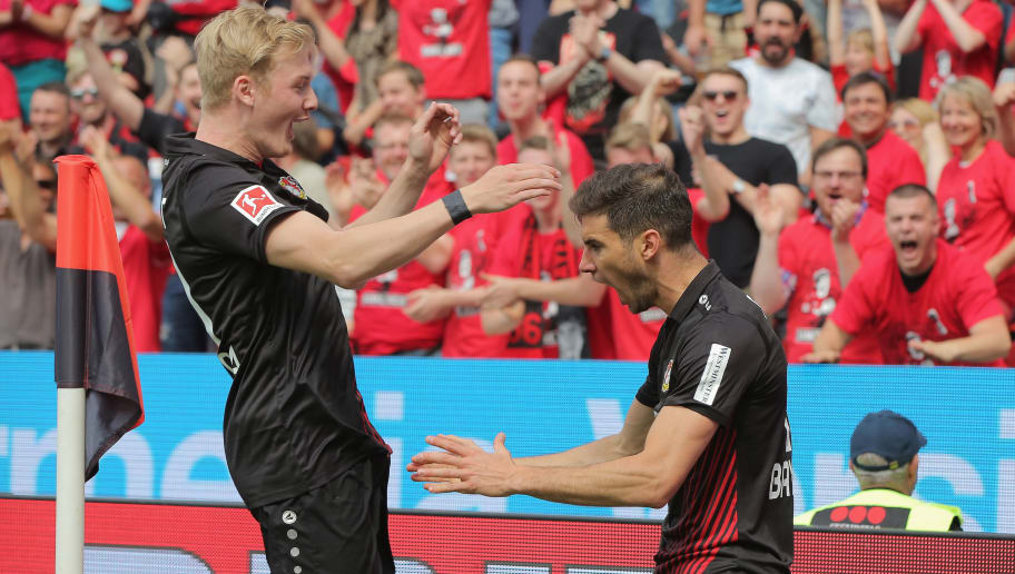LEVERKUSEN, GERMANY - MAY 12: Julian Brandt of Leverkusen (L) and Lucas Alario celebrate after scoring during the Bundesliga match between Bayer 04 Leverkusen and Hannover 96 at BayArena on May 12, 2018 in Leverkusen, Germany. (Photo by Juergen Schwarz/Bongarts/Getty Images)