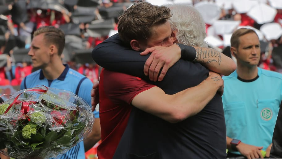 LEVERKUSEN, GERMANY - MAY 12: Rudi Voeller of Leverkusen (R) hugs Stefan Kiessling who is going to say farewell after the Bundesliga match between Bayer 04 Leverkusen and Hannover 96 at BayArena on May 12, 2018 in Leverkusen, Germany. (Photo by Juergen Schwarz/Bongarts/Getty Images)