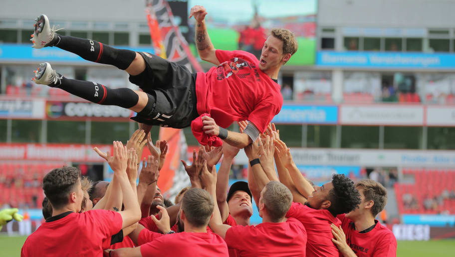 LEVERKUSEN, GERMANY - MAY 12: Stefan Kiessling of Leverkusen is thrown in the air after the Bundesliga match between Bayer 04 Leverkusen and Hannover 96 at BayArena on May 12, 2018 in Leverkusen, Germany. (Photo by Juergen Schwarz/Bongarts/Getty Images)