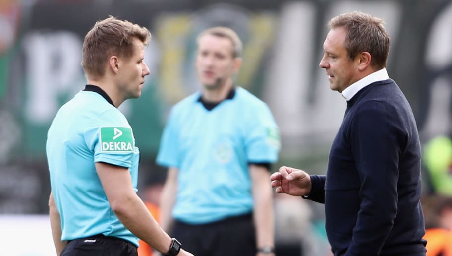 LEVERKUSEN, GERMANY - OCTOBER 20:  Head coach Andre Breitenreiter of Hannover discusses with referee Patrick Ittrich, after Ittrich gave a penalty for Leverkusen following a VAR decision during the Bundesliga match between Bayer 04 Leverkusen and Hannover 96 at BayArena on October 20, 2018 in Leverkusen, Germany.  (Photo by Alex Grimm/Bongarts/Getty Images)