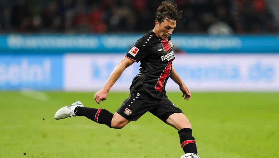 LEVERKUSEN, GERMANY - NOVEMBER 03: Julian Baumgartlinger #15 of Bayer Leverkusen controls the ball during the Bundesliga match between Bayer 04 Leverkusen and TSG 1899 Hoffenheim at BayArena on November 3, 2018 in Leverkusen, Germany. (Photo by Maja Hitij/Bongarts/Getty Images)