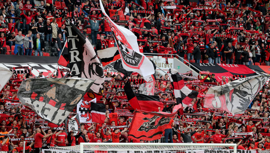 LEVERKUSEN, GERMANY - APRIL 28: Fans of Leverkusen wave flags during the Bundesliga match between Bayer 04 Leverkusen and VfB Stuttgart at BayArena on April 28, 2018 in Leverkusen, Germany. The match between Leverkusen and Stuttgart ended 0-1. (Photo by Christof Koepsel/Bongarts/Getty Images)