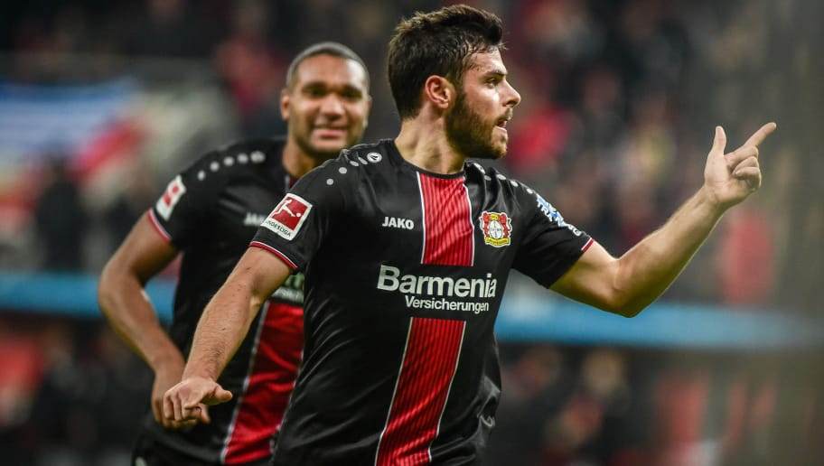 LEVERKUSEN, GERMANY - NOVEMBER 23: Kevin Volland of Leverkusen celebrates after scoring his team's first goal with team mates during the Bundesliga match between Bayer 04 Leverkusen and VfB Stuttgart at BayArena on November 23, 2018 in Leverkusen, Germany. (Photo by TF-Images/Getty Images)