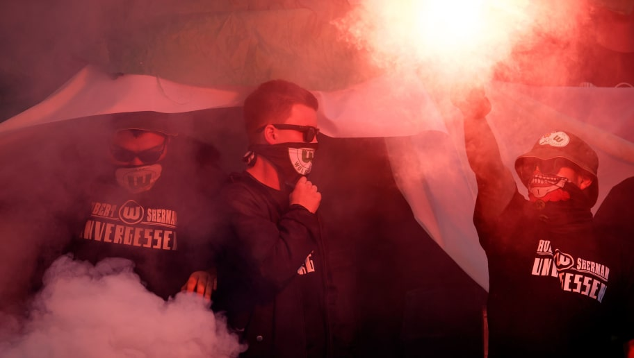 LEVERKUSEN, GERMANY - OCTOBER 15:  Fans of Wolfsburg are seen prior to the Bundesliga match between Bayer 04 Leverkusen and VfL Wolfsburg at BayArena on October 15, 2017 in Leverkusen, Germany.  (Photo by Lars Baron/Bongarts/Getty Images)
