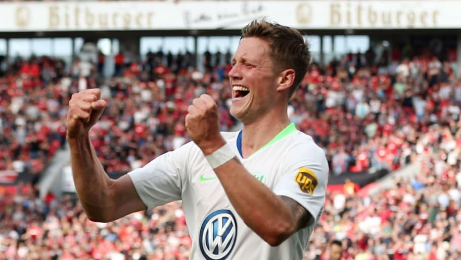 LEVERKUSEN, GERMANY - SEPTEMBER 01: Out Weghorst of Wolfsburg celebrates the second goal during the Bundesliga match between Bayer 04 Leverkusen and VfL Wolfsburg at BayArena on September 1, 2018 in Leverkusen, Germany. (Photo by Christof Koepsel/Bongarts/Getty Images)