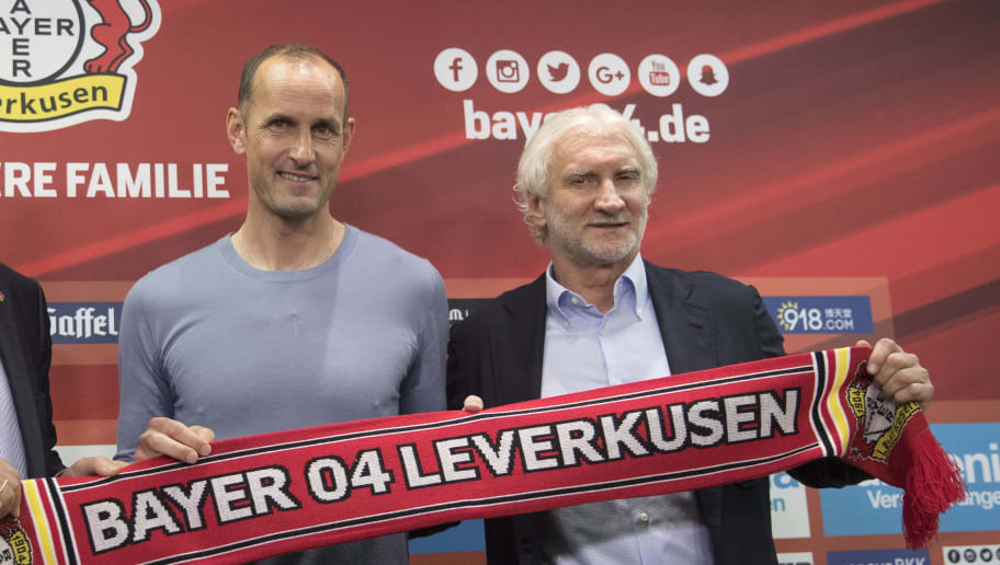 LEVERKUSEN, GERMANY - JUNE 09: Team manager Rudi Voeller of Bayer Leverkusen (R-L), the newly appointed head coach Heiko Herrlich and chairman Michael Schade pose after a press conference at BayArena on June 9, 2017 in Leverkusen, Germany. (Photo by Maja Hitij/Bongarts/Getty Images)