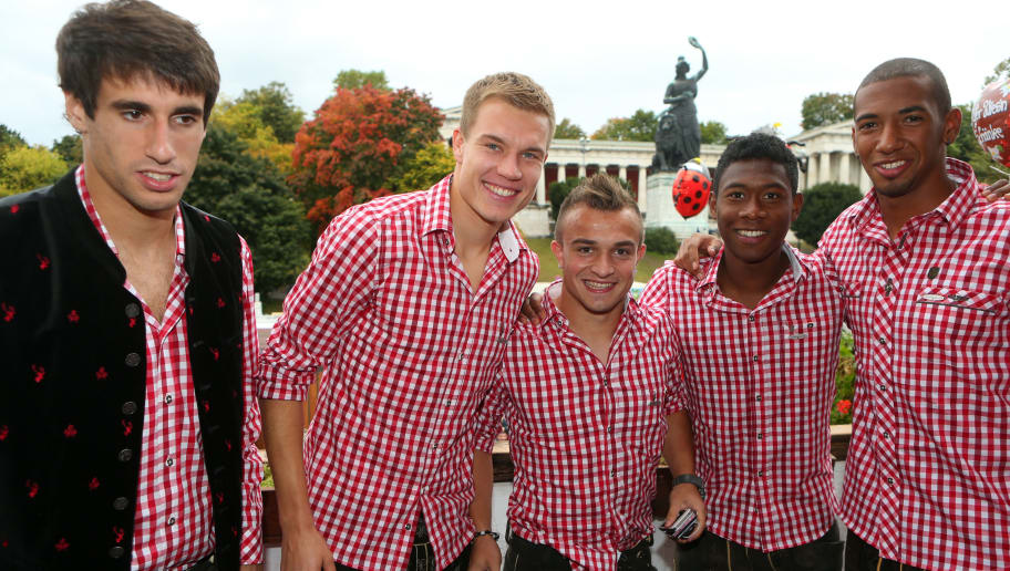 MUNICH, GERMANY - OCTOBER 07:  Javi Martinez (L) of FC Baqyern Muenchen attends with his team mates Holger Badstuber (2nd L), Xherdan Shaqiri (C), David Alaba (2nd R) and Jerome Boetang (R)  the Oktoberfest beer festival at the Kaefer Wiesnschaenke tent on October 7, 2012 in Munich, Germany.  (Photo by Alexander Hassenstein/Bongarts/Getty Images)