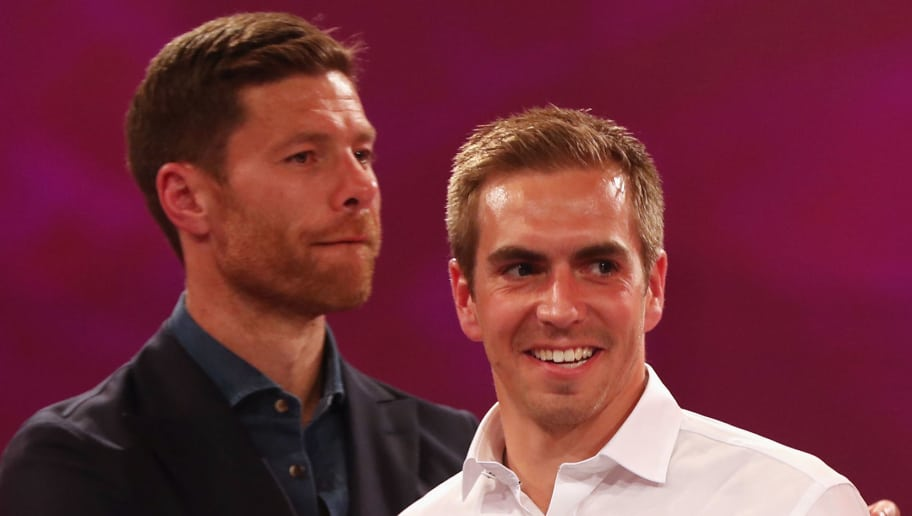 MUNICH, GERMANY - MAY 20: Xabi Alonso hugs Philipp Lahm during the FC Bayern Muenchen Championship party following the Bundesliga match between Bayern Muenchen and SC Freiburg at Postpalast on May 20, 2017 in Munich, Germany.  (Photo by Alexandra Beier/Bongarts/Getty Images)