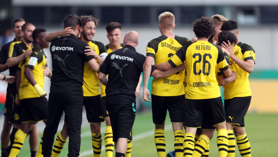 MUNICH, GERMANY - JUNE 17:  Players of Borussia Dortmund celebrate their second goal during the B Juniors German Championship final between FC Bayern Muenchen U17 and Borussia Dortmund U17 on June 17, 2018 in Munich, Germany.  (Photo by Alexandra Beier/Bongarts/Getty Images)