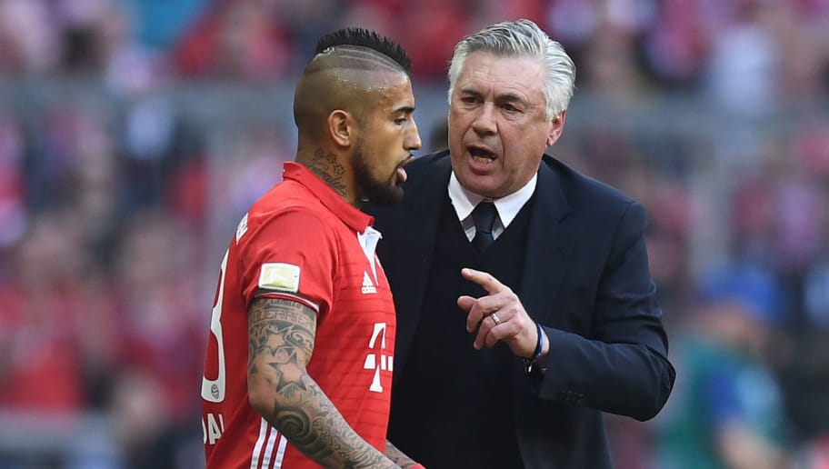 MUNICH, GERMANY - APRIL 08: Carlo Ancelotti (R), head coach of FC Bayern Muenchen talks to Arturo Vidal during the Bundesliga match between Bayern Muenchen and Borussia Dortmund at Allianz Arena on April 8, 2017 in Munich, Germany. (Photo by Lennart Preiss/Bongarts/Getty Images)