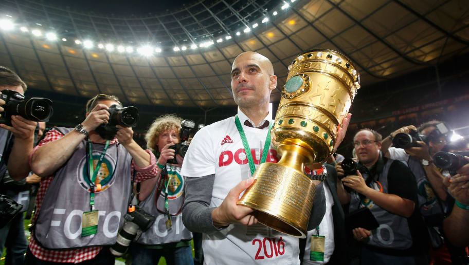 BERLIN, GERMANY - MAY 21:  Pep Guardiola of Bayern Muenchen celebrates victory after the DFB Cup final match between FC Bayern Muenchen and Borussia Dortmund at Olympiastadion on May 21, 2016 in Berlin, Germany.  (Photo by Boris Streubel/Bongarts/Getty Images)