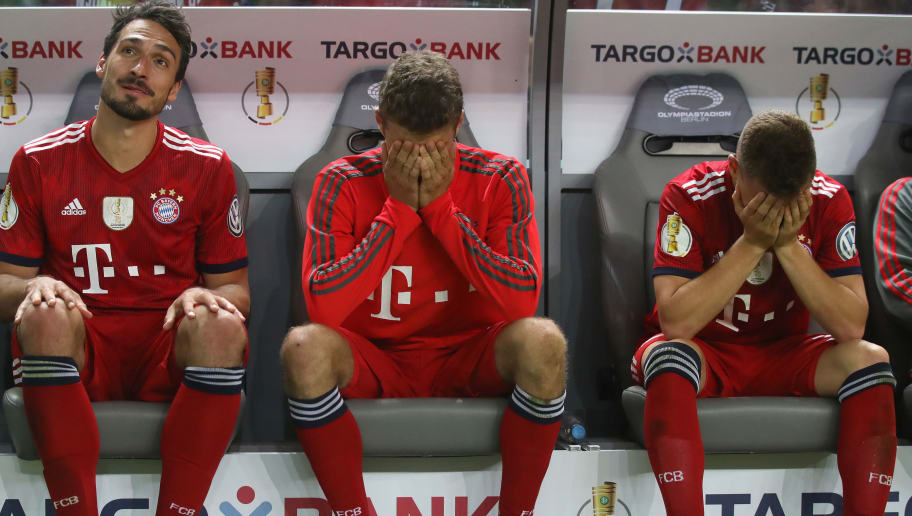 BERLIN, GERMANY - MAY 19:  Mats Hummels (L), Thomas Mueller (C) and Joshua Kimmich of Bayern Muenchen are dejected after losing the DFB Cup final against Eintracht Frankfurt at Olympiastadion on May 19, 2018 in Berlin, Germany. (Photo by Alexander Hassenstein/Bongarts/Getty Images)