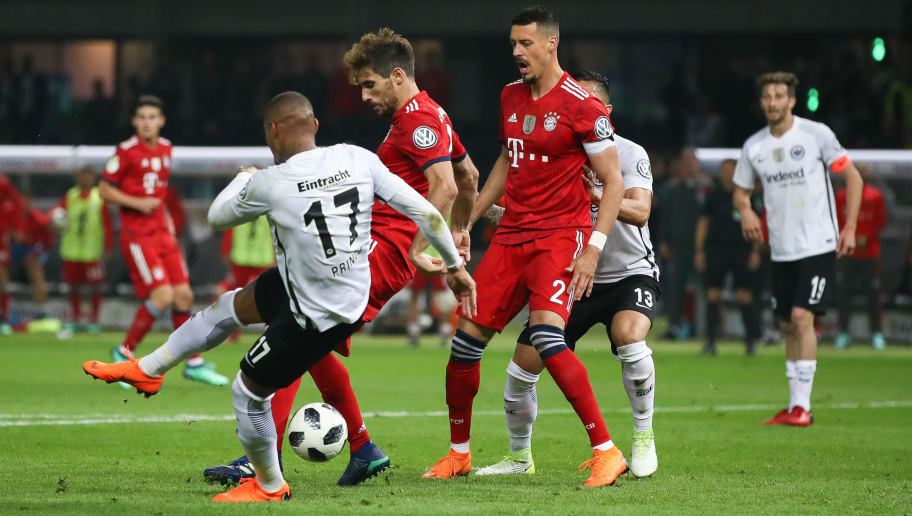 BERLIN, GERMANY - MAY 19: Javi Martinez #8 of FC Bayern Muenchen is challenged by Kevin-Prince Boateng #17 of Eintracht Frankfurt during the DFB Cup final between Bayern Muenchen and Eintracht Frankfurt at Olympiastadion on May 19, 2018 in Berlin, Germany. (Photo by Maja Hitij/Bongarts/Getty Images)