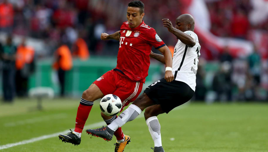 BERLIN, GERMANY - MAY 19:  Thiago (L) of Bayern Muenchen is challenged by Jetro Willems (R) of Eintracht Frankfurt during the DFB Cup final between Bayern Muenchen and Eintracht Frankfurt at Olympiastadion on May 19, 2018 in Berlin, Germany.  (Photo by Lars Baron/Bongarts/Getty Images)